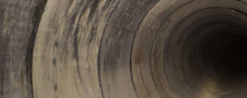 Inside a sewer pipe.